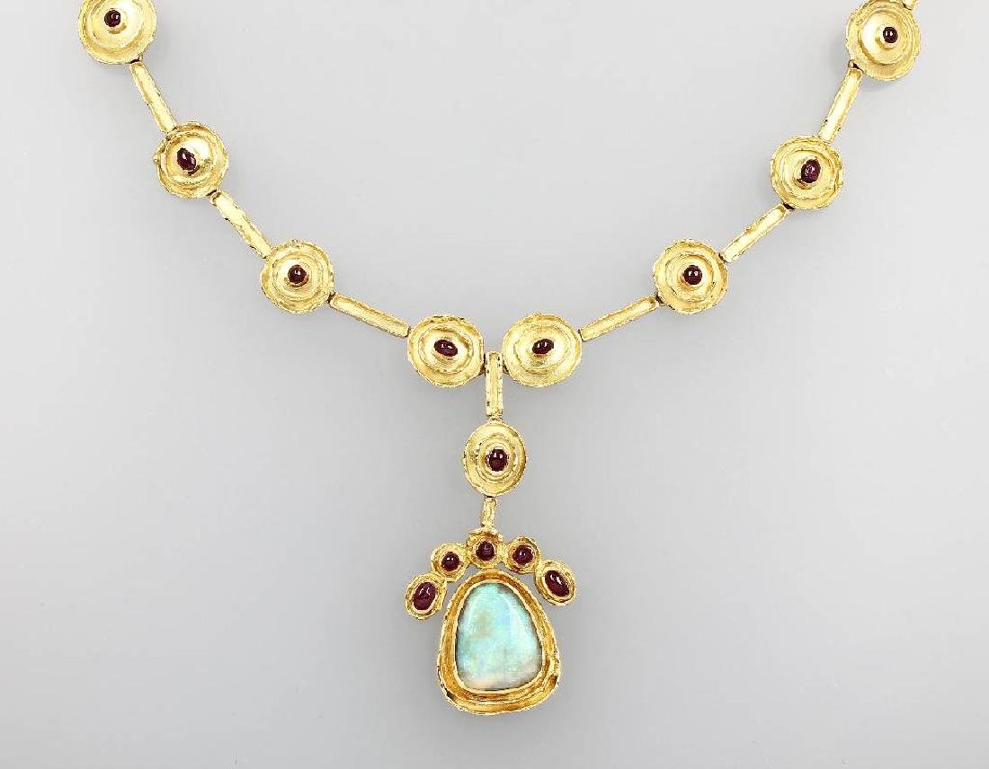 18 kt gold designernecklace with opal and rubies