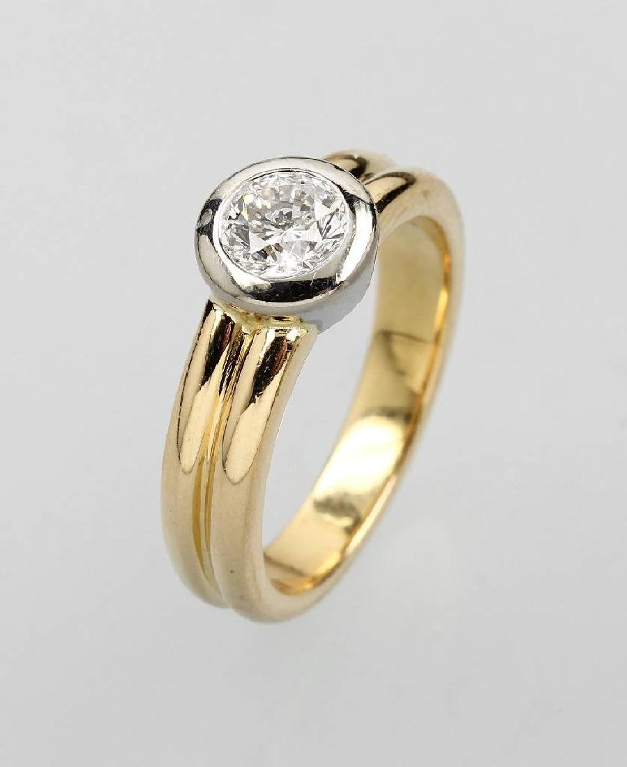 18 kt gold solitaire ring with brilliant