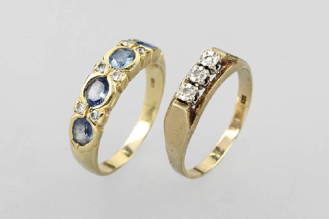 Lot 2 gold rings with diamonds