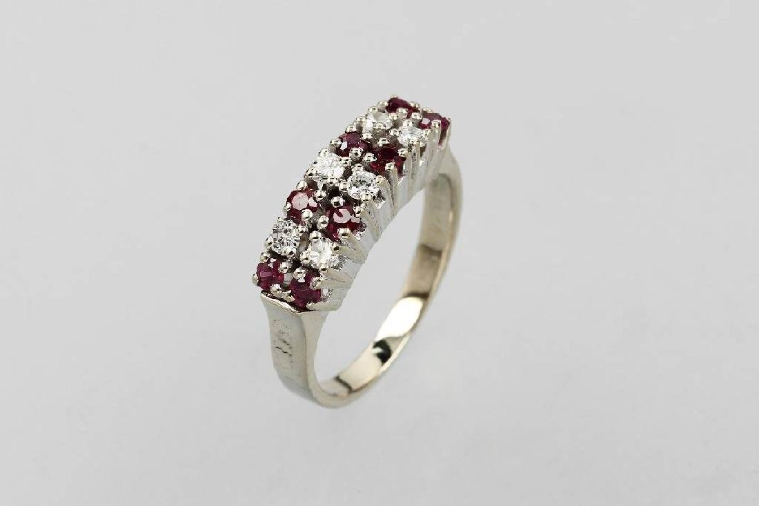 14 kt gold ring with brilliants and rubies