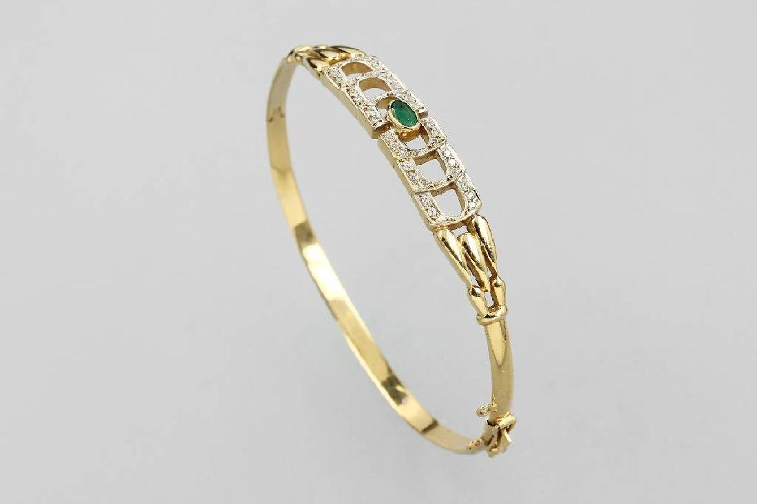 18 kt gold bangle with emerald