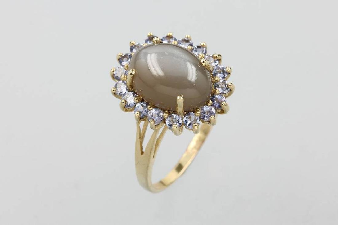 14 kt gold ring with moonstone and tanzanites