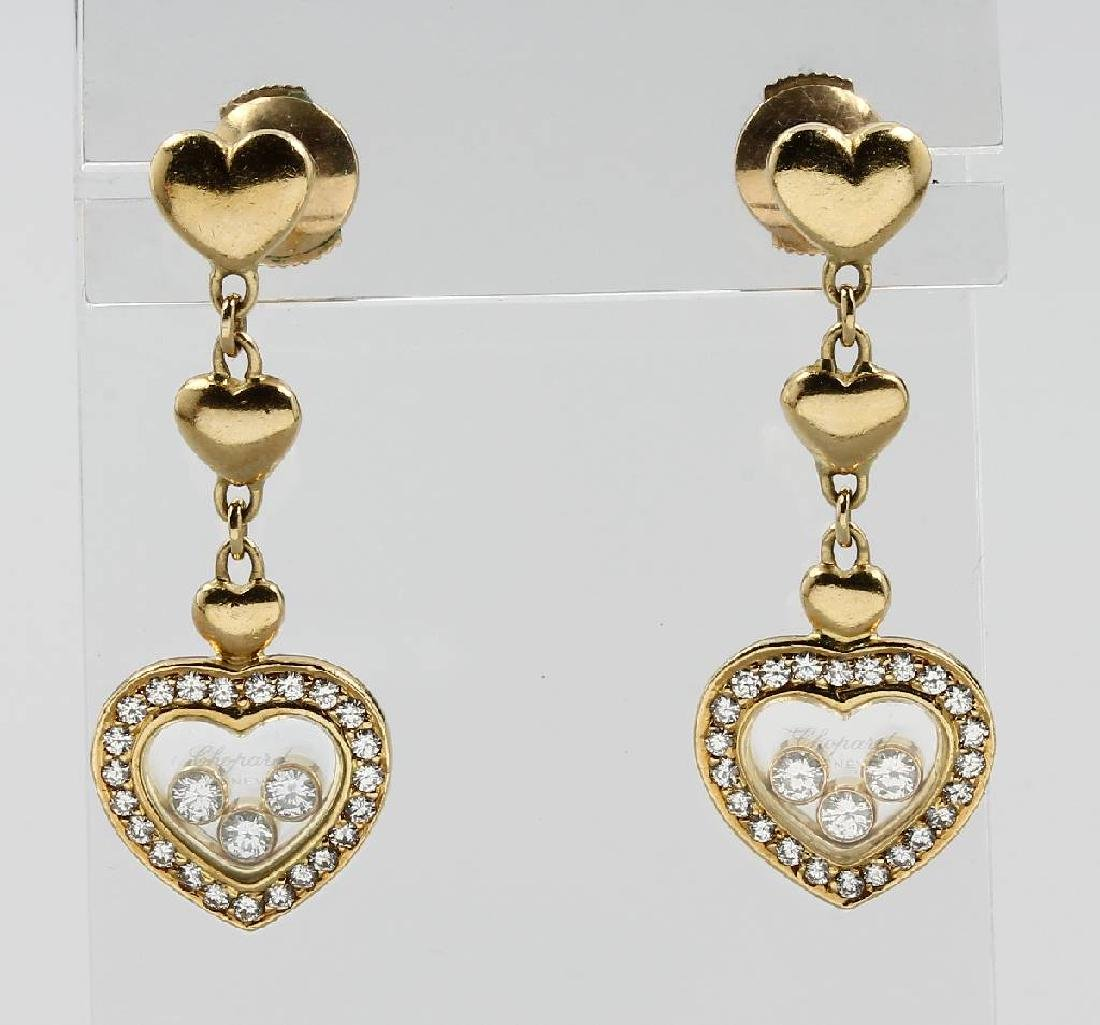 Pair of 18 kt gold Chopard earrings with diamonds