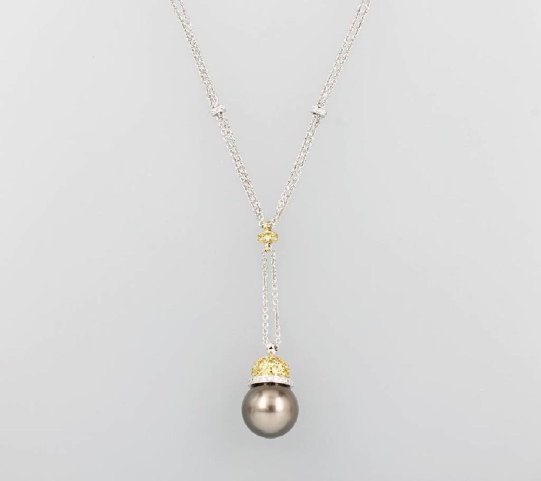 18 kt gold Y-necklace with cultured tahitian pearl,