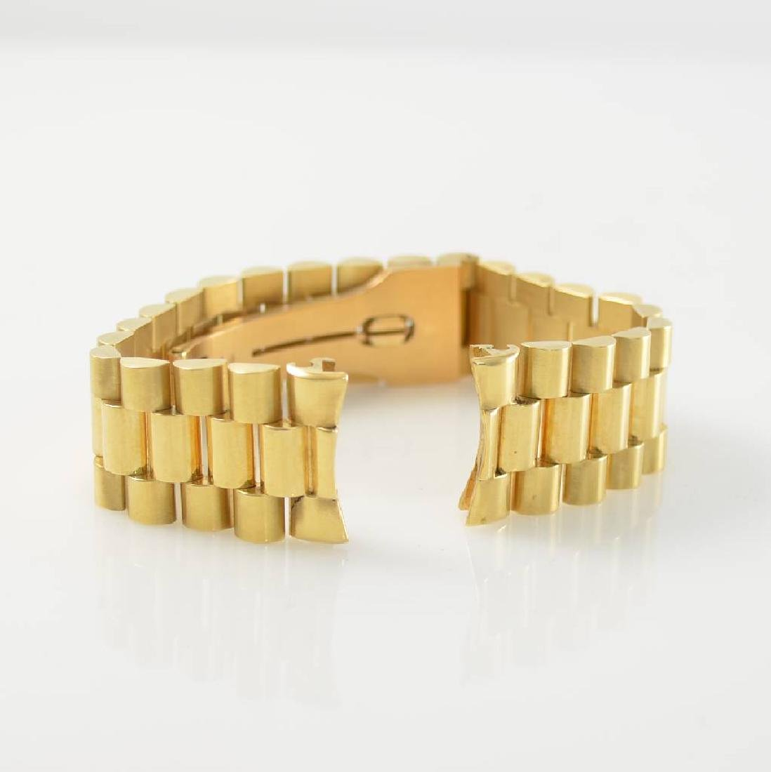 Watch-bracelet in 18k gold with deployant clasp