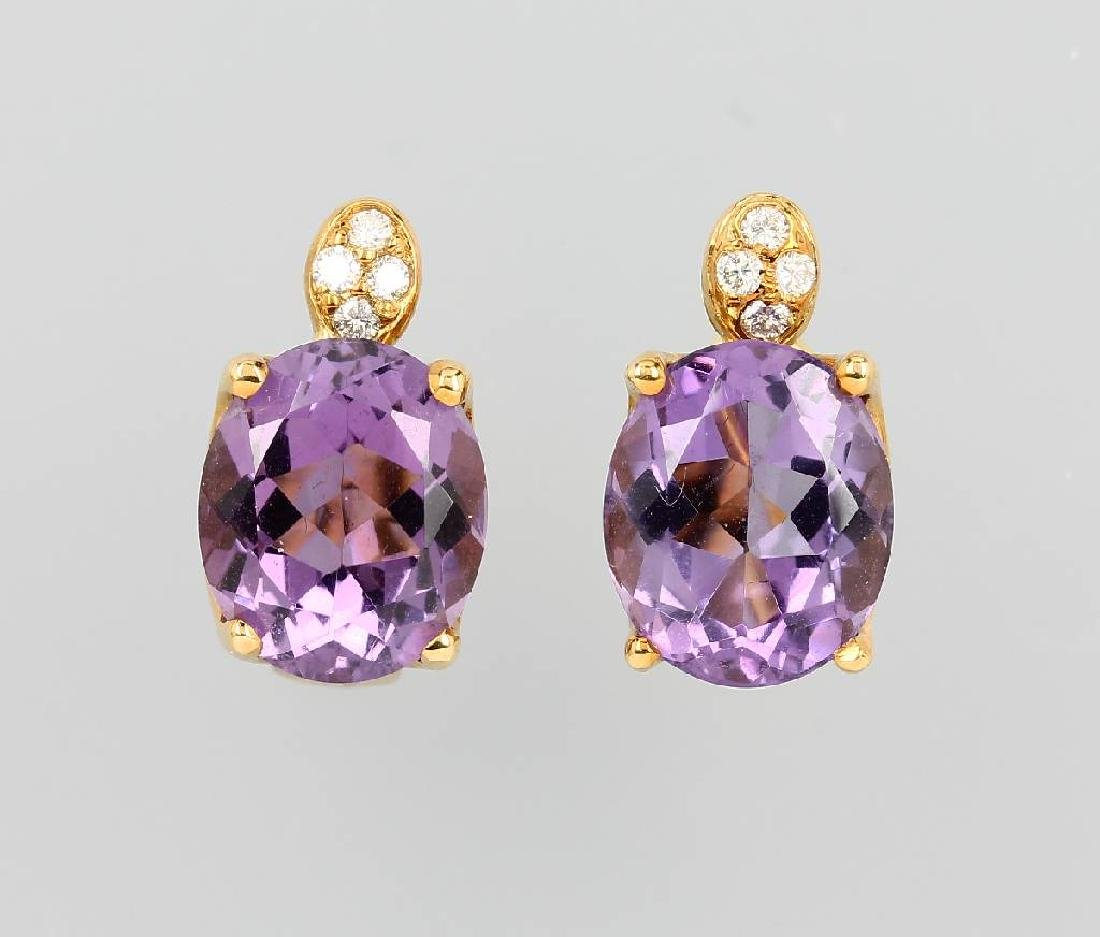 Pair of 18 kt gold STERN earclips with amethysts and