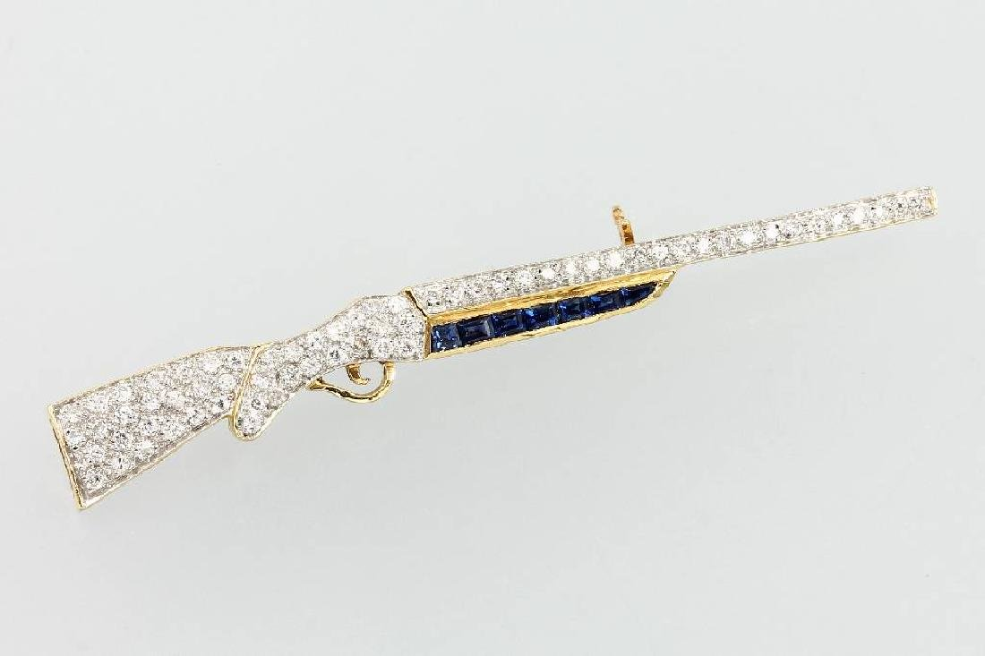 18 kt gold Brooch 'rifle' with brilliants and sapphires