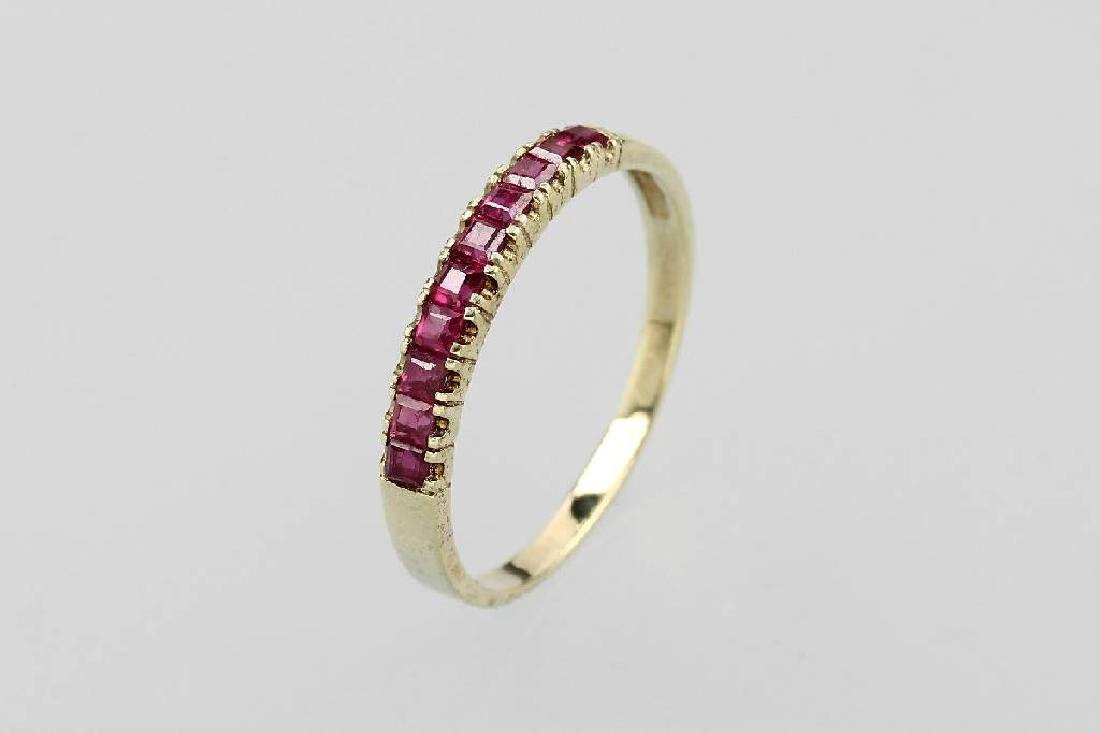 14 kt gold ring with rubies