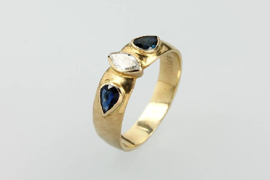 14 kt gold ring with diamond and sapphires