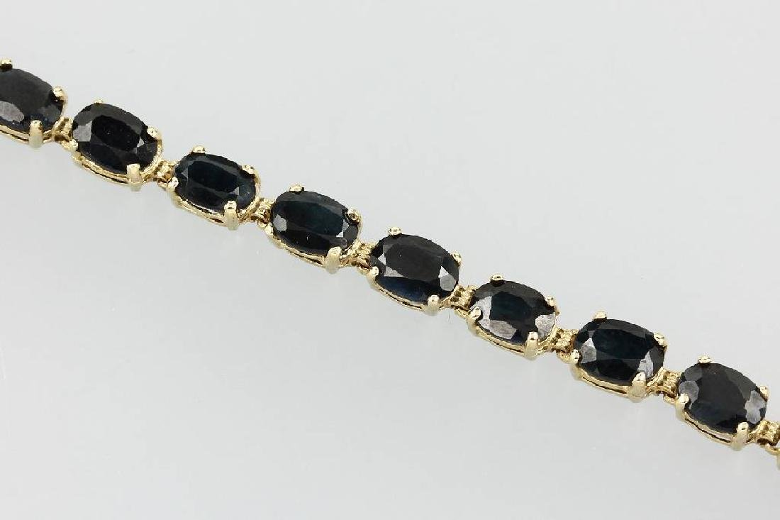 10 kt gold bracelet with sapphires