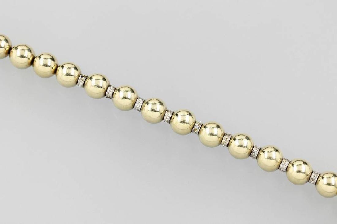 14 kt gold sphere bracelet