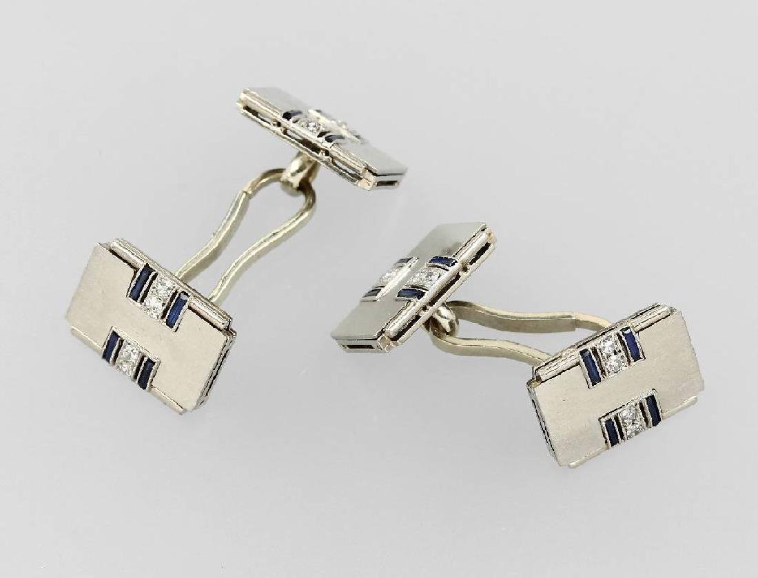 Pair of platinum cuff links with sapphires anddiamonds