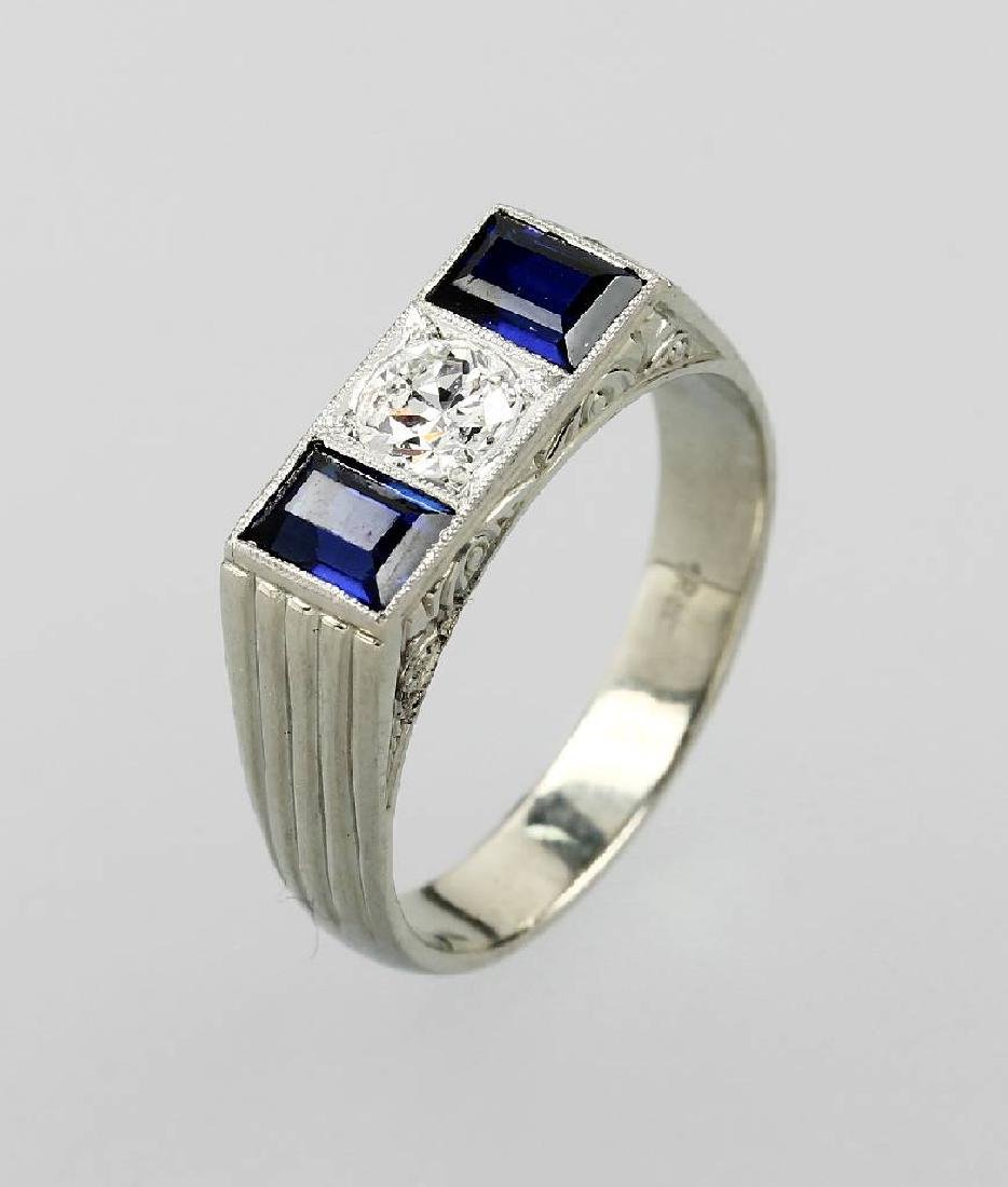 18 kt gold ring with synth. sapphires and diamond