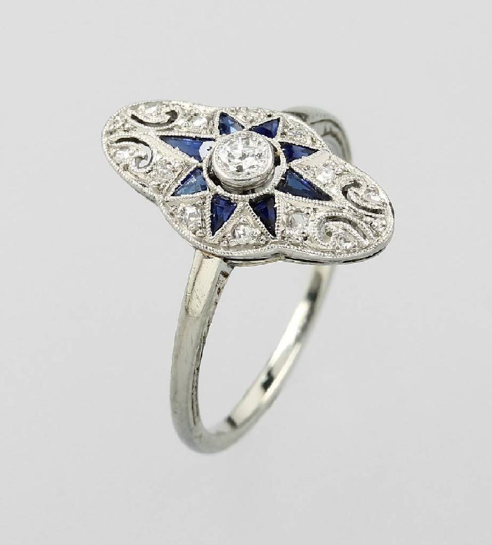 Platinum marquise ring with sapphires and diamonds