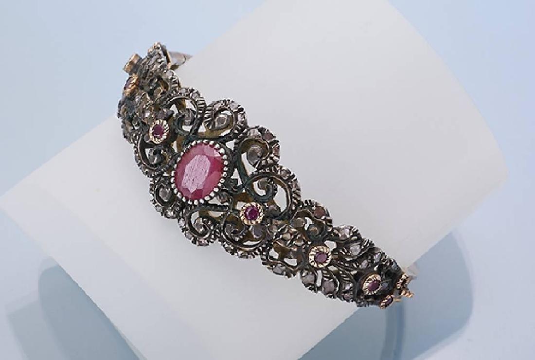 Bangle with rubies and diamonds, YG 585/000 and silver
