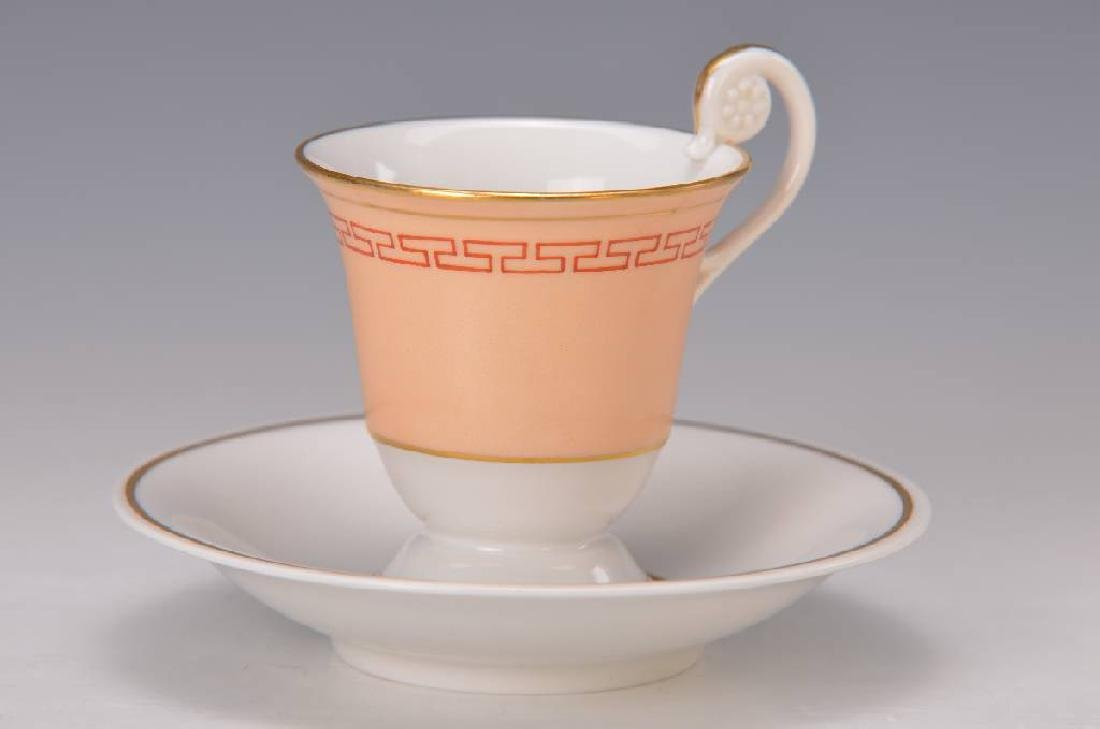 two cups with saucer