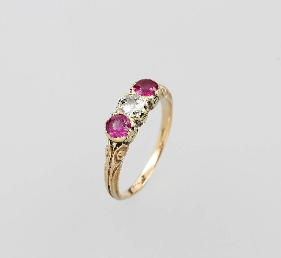 18 kt gold ring with rubies and diamond