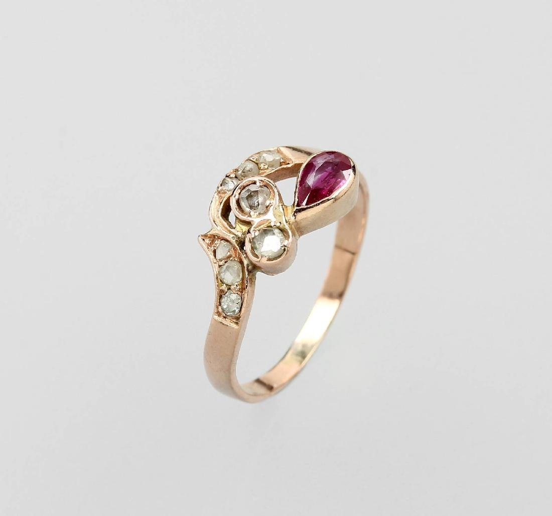 14 kt gold ring with synth. ruby and diamonds