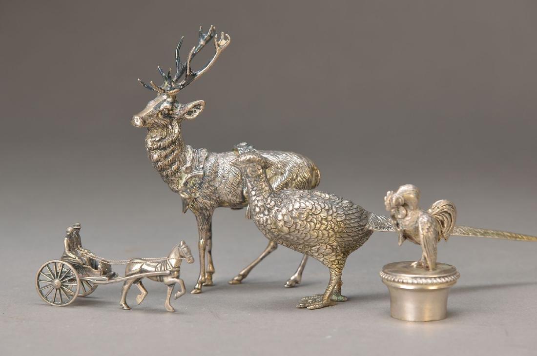 three silver sculptures