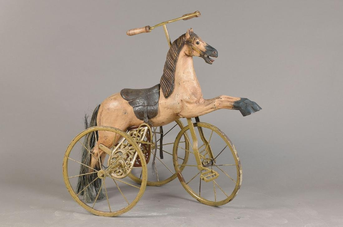 tricycle with carousel horse