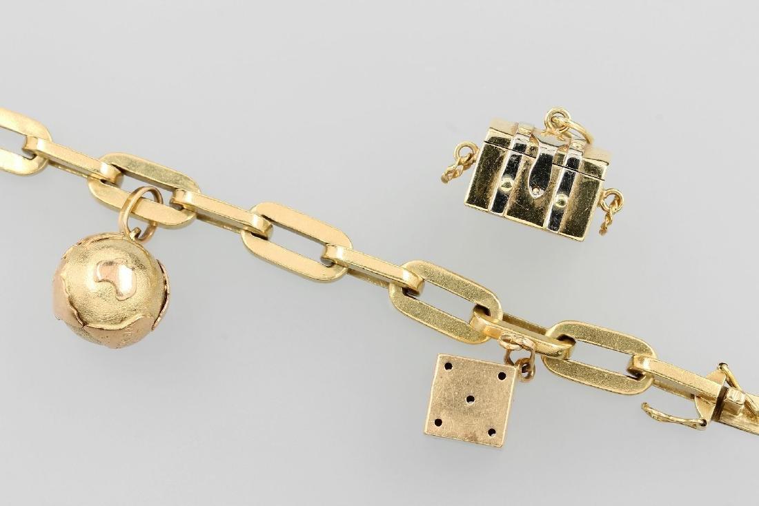 18 kt gold charm bracelet with 3 suspensions