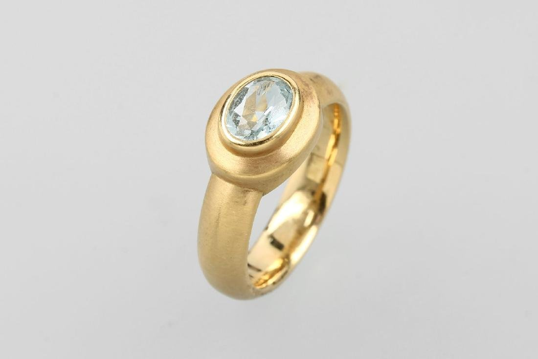 18 kt gold ring with topaz