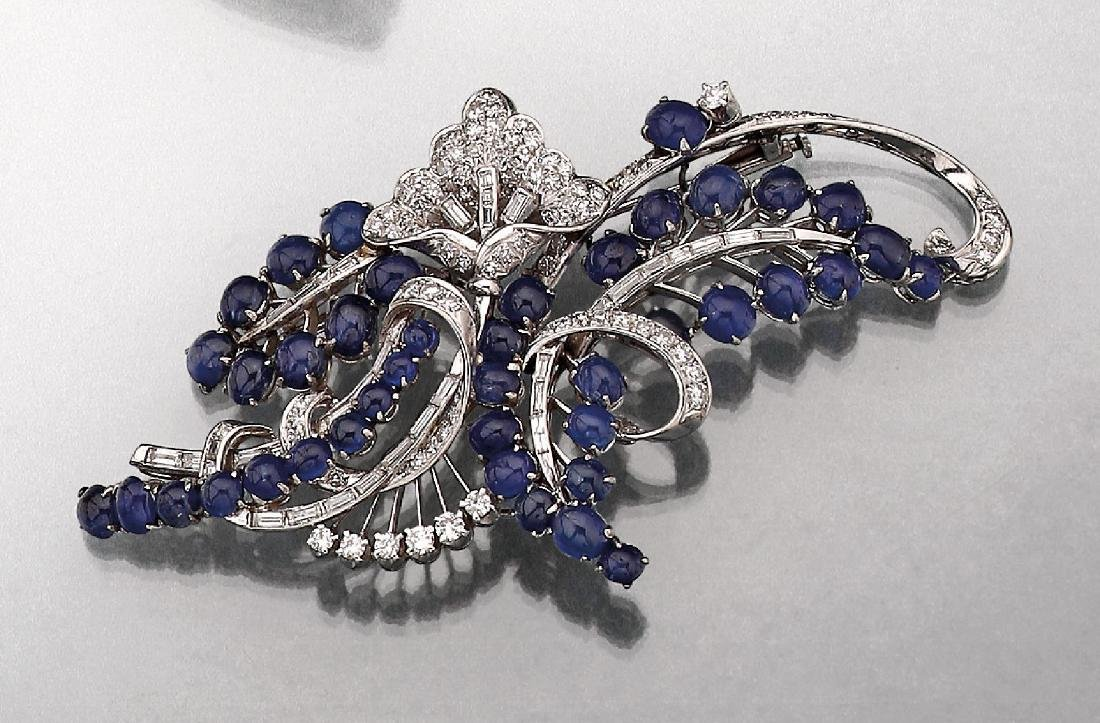 Platinum brooch with brilliants and sapphires