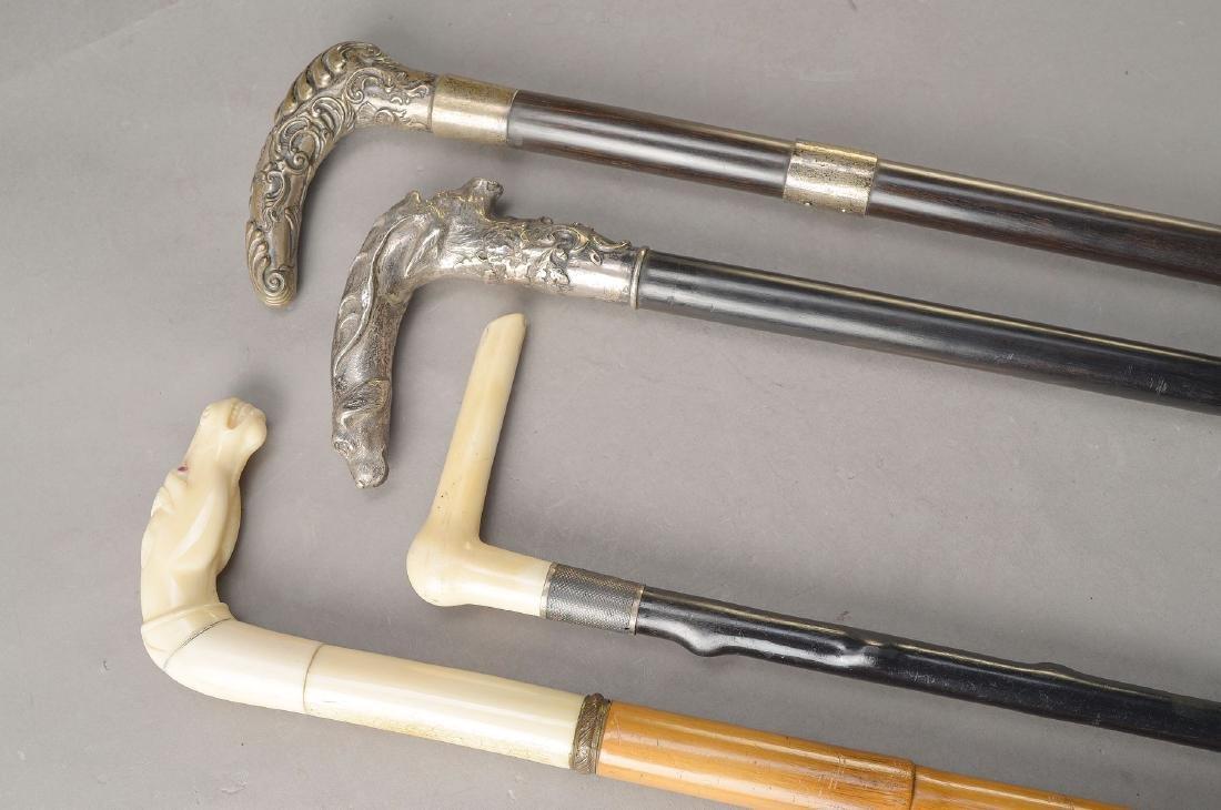 2 canes, England, around 1890-1900, handles ofbone, 1