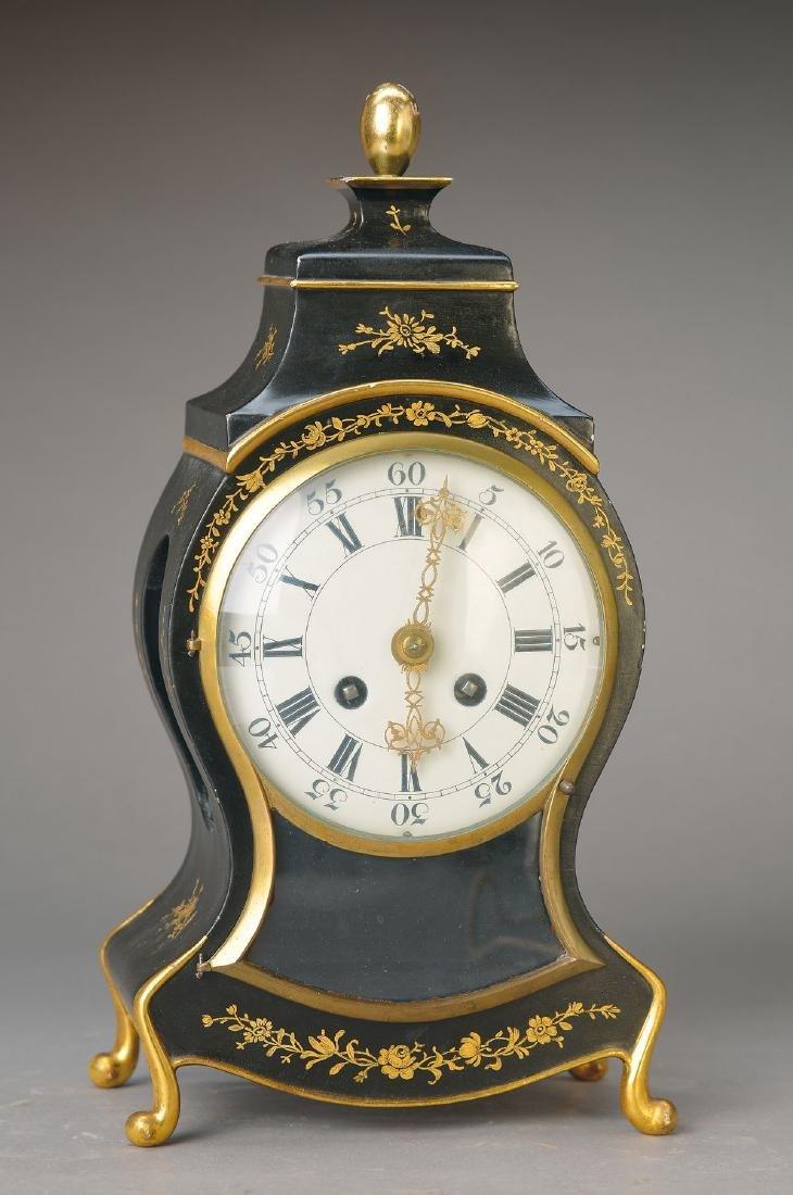 table clock, in shape of a Neuenburg Pendulum,around