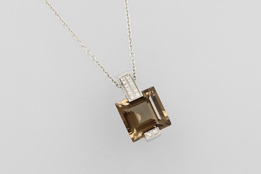 18 kt gold pendant with smoky quartz and brilliants