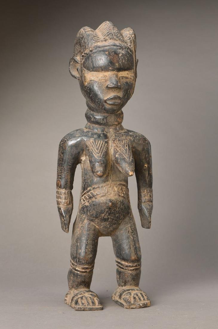 Standing female figure, Dan, Liberia, strong influence