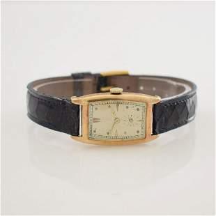 IWC rare 14k yellow gold tonneaushaped wristwatch