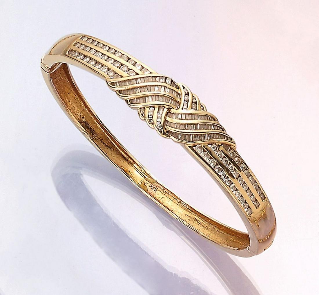 14 kt gold bangle with diamonds