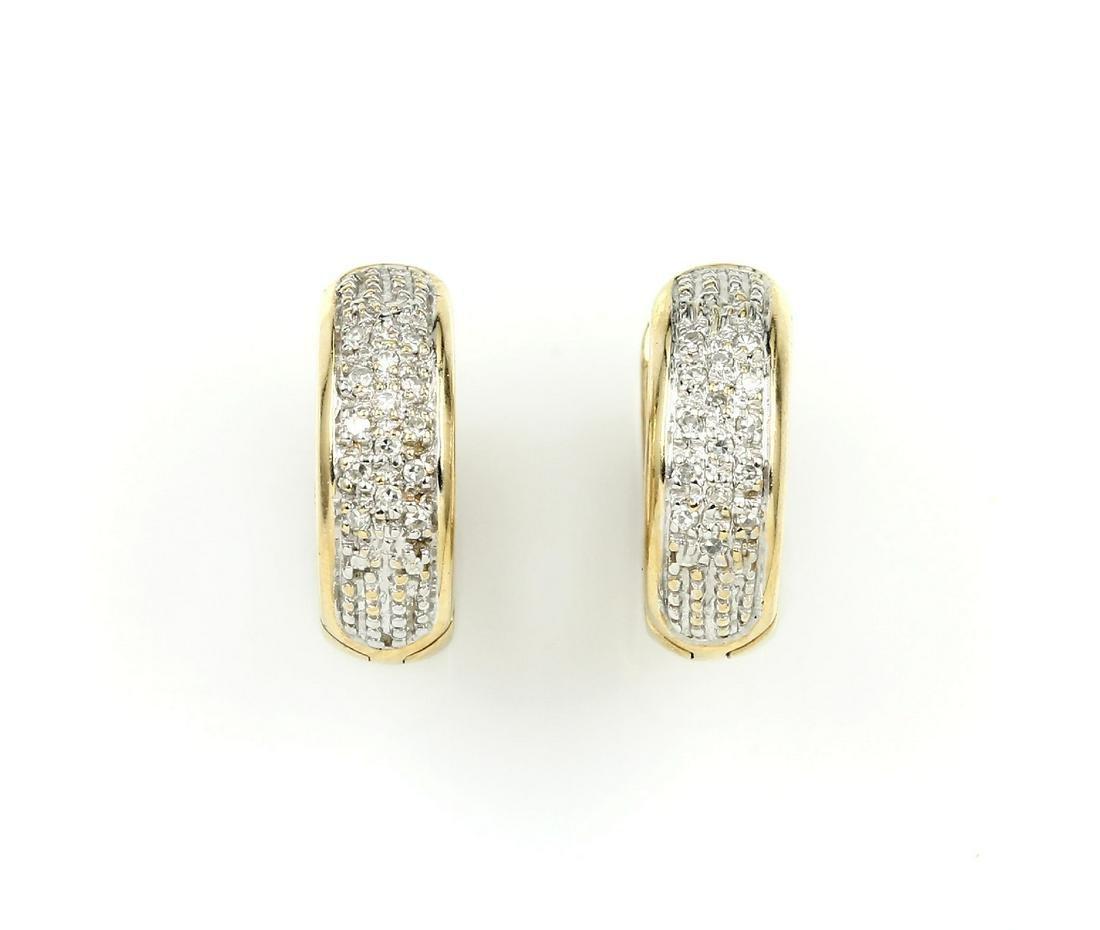 Pair of 14 kt gold hoop earrings with diamonds
