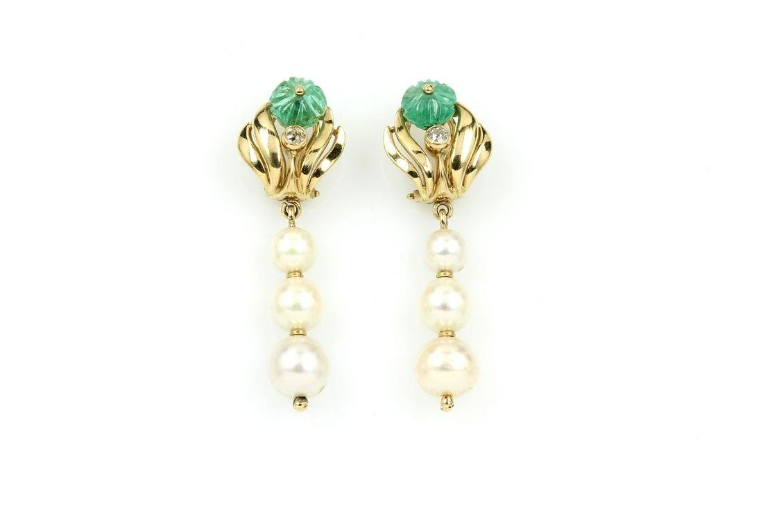 Pair of 18 kt gold ear clips pearls, diamonds and