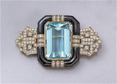 18 kt gold brooch with aquamarine, brilliants and onyx