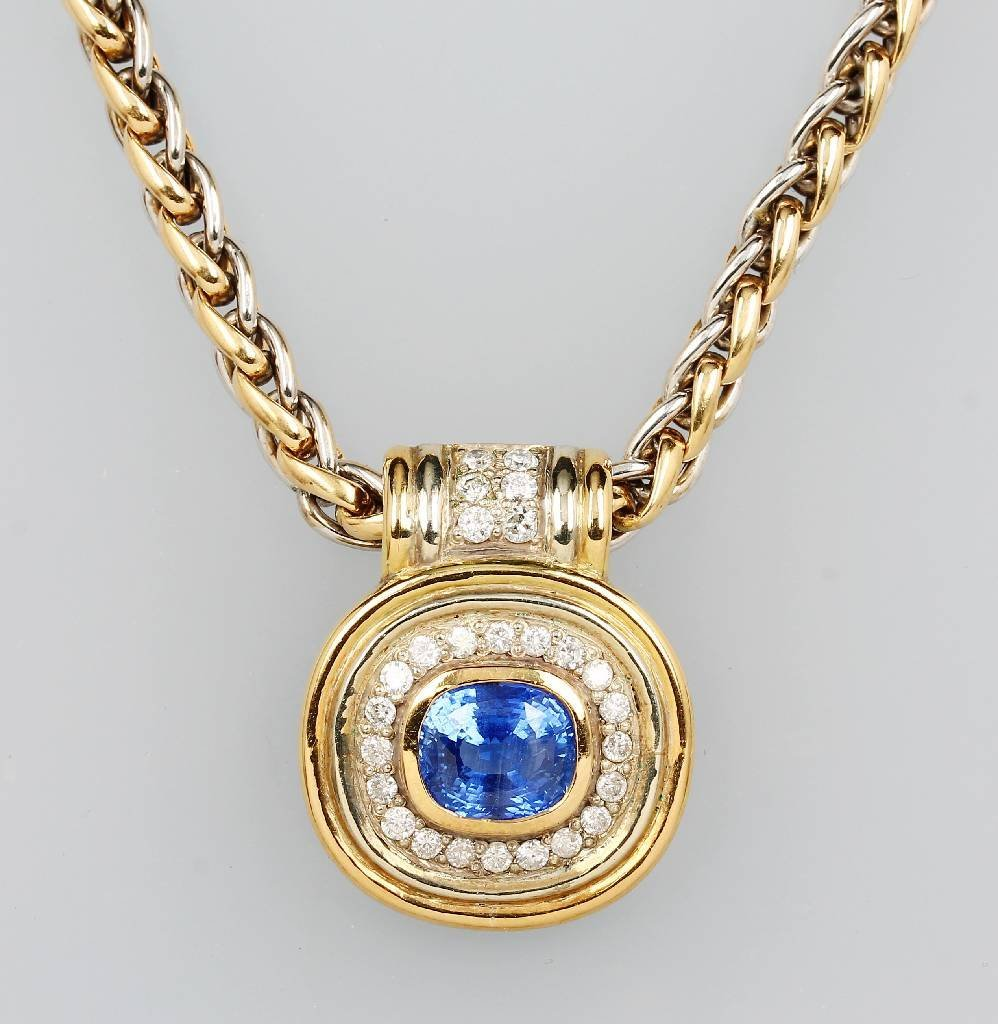 18 kt Gold pendant with sapphire and diamonds