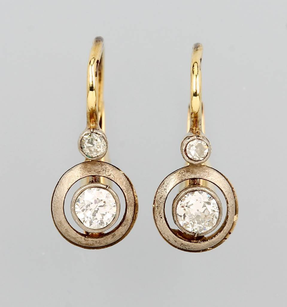14 kt gold and silver earrings with diamonds