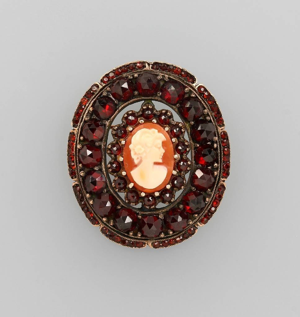Brooch with shell cameo and garnets, silver gilded
