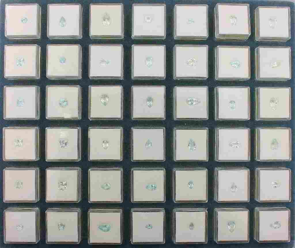 Big tray with 84 boxes with bevelled aquamarines