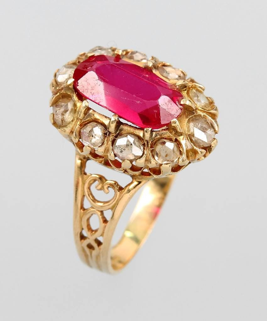 18 kt gold ring with synth. ruby and diamonds