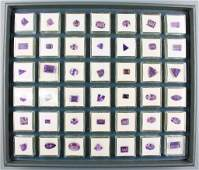 Tray with 42 boxes with bevelled amethysts