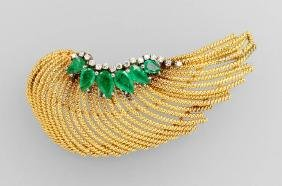 18 kt gold brooch with emeralds and diamonds