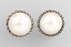 Pair of 18 kt gold earclips with mabepearls