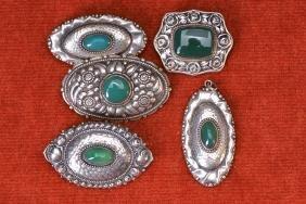 Five broochs