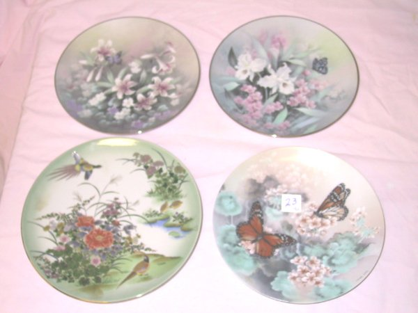 23: Lot of 4 Collector Plates
