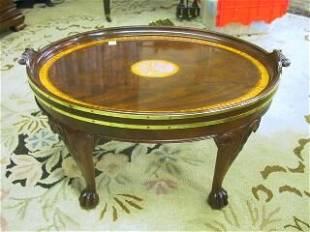 Mahogany Baker Oval Coffee Table.