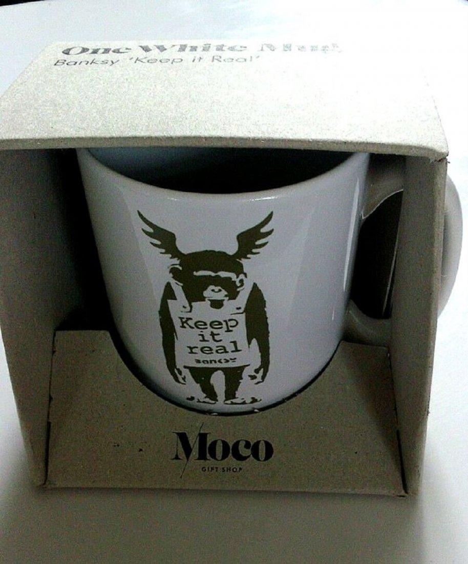 Banksy porcelain mug from the Moco Museum
