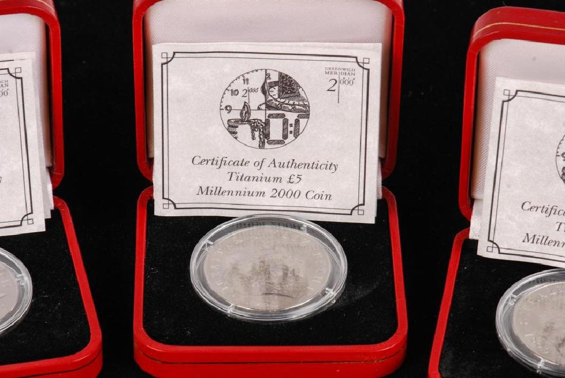 (4) TITANANIUM 5 POUND COINS (1) SILVER DOLLAR ETC - 5