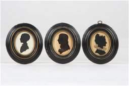 THREE FOLK ART CUT PAPER SILHOUETTES OF A FAMILY